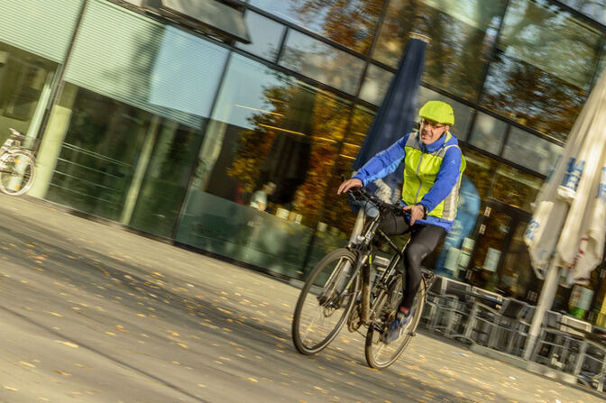A cyclist in front of the SuperC